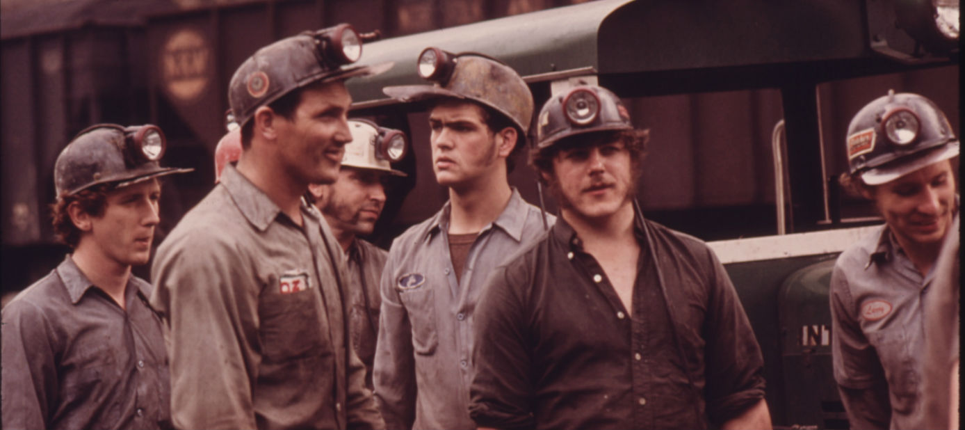 GROUP_OF_MINERS_WAITING_TO_GO_TO_WORK_ON_THE_4_P
